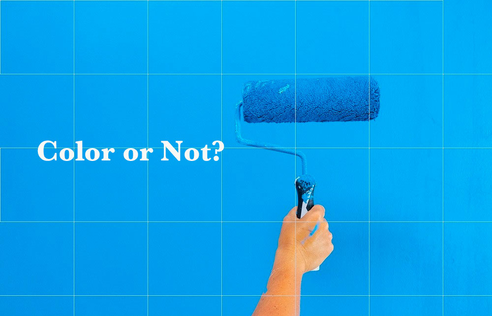Paint roller on blue wall