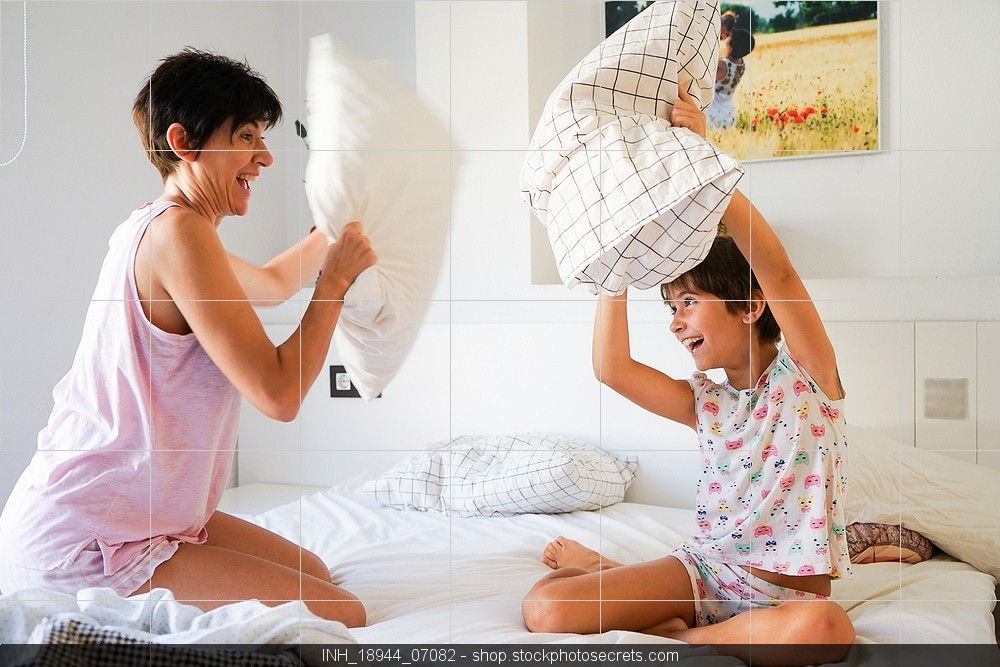 Mom and daughter pillow fight