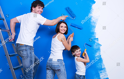 Family painting a wall blue